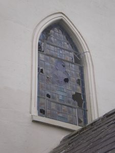 The strike drove chunks of plaster down the aisle and through the leaded window at the other end of the church, a distance of 28 Metres approx.